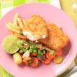 Fried fish with French fries and mixed vegetables - Stock Photo