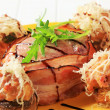Стоковое фото: Mushrooms stuffed with ground meat and bacon-wrapped pork fillet