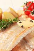 Pan fried fish fillets and potatoes — Stock Photo