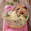 Soup with cheese and ham — Stock Photo