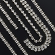 Stock Photo: Silver necklaces and bracelets with gemstones