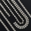 Silver necklaces and bracelets with gemstones — Stock Photo
