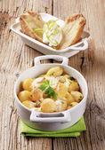 Batatas e creme de leite — Fotografia Stock