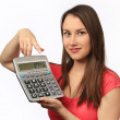 Young woman holding a calculator — Stock Photo