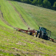 Stock Photo: Tractor with a rotary rake in the field