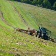 Tractor with rotary rake in field — Stock Photo #9538223