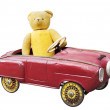 Old teddy bear in a vintage toy car — Stock Photo