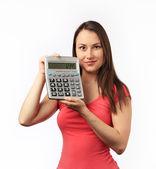 Jonge vrouw met een rekenmachine — Stockfoto