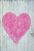 Wooden door with pink heart — Stock Photo