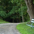 Park Bench by trail — Stock Photo