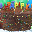 Stock Photo: Chocolate cake with Happy Birthday candles. Selective focus on