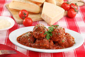 Italian meatballs in an oval dish. — Stock Photo