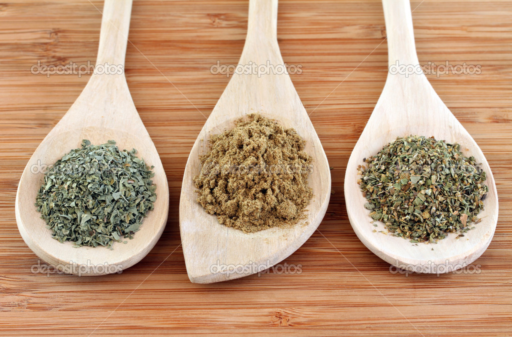 Dried spices of Cilantro, Cumin and Oregano used in Mexican cooking on Wooden Spoons. — Stock Photo #10127733