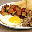 Stock Photo: Fried egg, home fries and hash breakfast.