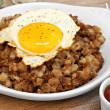 Stock Photo: Fried egg on top of roast beef hash.