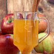 Royalty-Free Stock Photo: Apple cider with cinnamon sticks and apples.