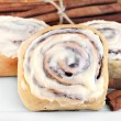 Постер, плакат: Fresh cinnamon buns with selective foucs