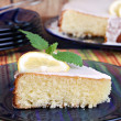 Lemon cake garnished with a slice of lemon and lemon mint. — Stock Photo