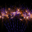 Beautiful fireworks in purple and gold — Stock Photo
