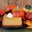 Постер, плакат: Pumpkin cheesecake in autumn setting