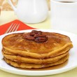 Pumpkin pancakes with pecans and syrup. — Stock Photo