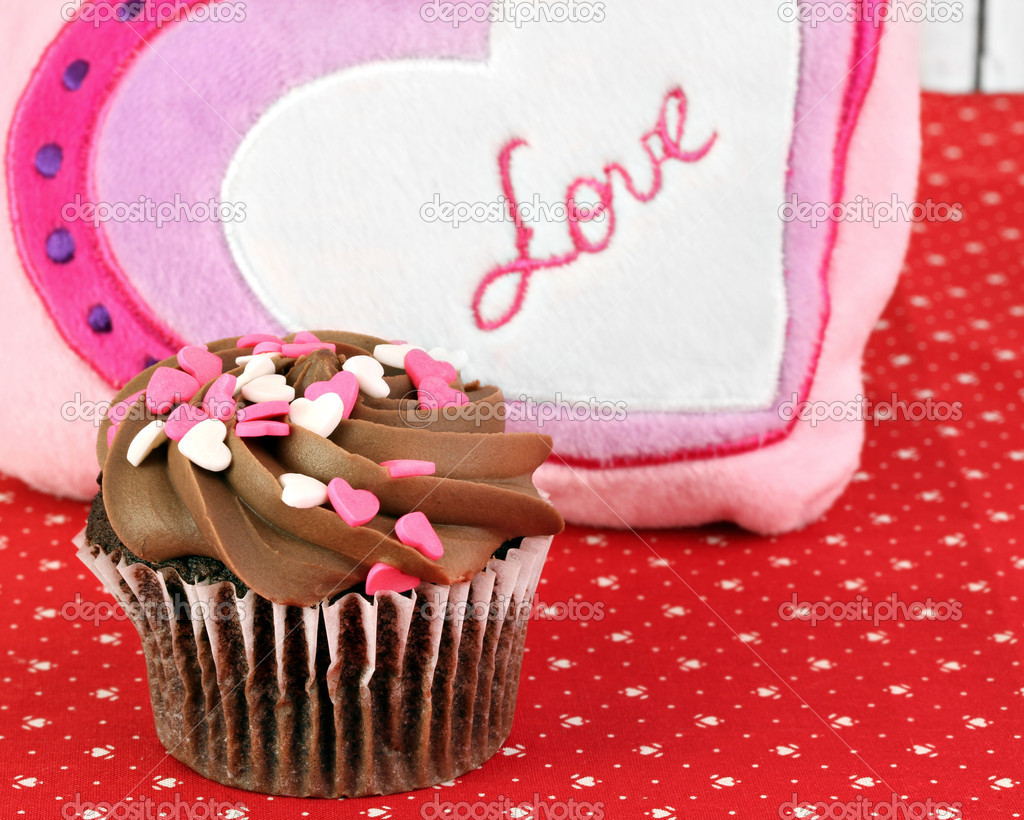 One chocolate cupcake, decorated for Valentines Day in front Love decoration. — Stock Photo #8771905