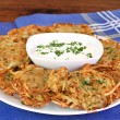 German Potato Pancakes and Sour Cream - Stock Photo
