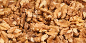 Closeup view of walnut purified on a black background — Stock Photo