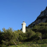 Lighthouse on the coast of the Mediterranean Sea, Sicily — Stock Photo #9013350