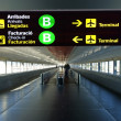 Stock Photo: Directional sign in BarcelonInternational airport