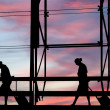 Royalty-Free Stock Photo: Silhouettes at airport building