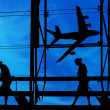Silhouettes at airport building — Stock Photo #9899078