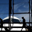 Silhouettes at airport building — Stock Photo #9899088