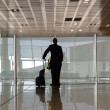 Stock Photo: Silhouettes at airport building