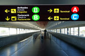 Directional sign in Barcelona International airport — Stock Photo