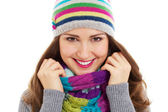 Beautiful girl in bright hat and scarf — Stock Photo