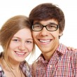 Lovely smiling teenage couple - Stock Photo