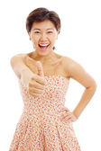 Pretty asian young woman shows thumb up — Stock Photo