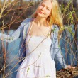 Spring young woman near river - Stock Photo