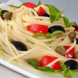 Stock Photo: Spaghetti with tomato, capers and basil with olives