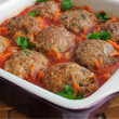 Stock Photo: Meatballs with herbs and tomato sauce in pan
