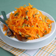 Salad of pumpkin and carrot with pumpkin seeds - Stock Photo