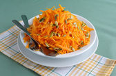 Salad of pumpkin and carrot with pumpkin seeds — Stock Photo