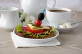 Sandwich with a cup of coffee and milk — Stock Photo