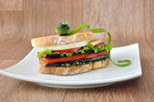 Sandwich with eggplant, tomatoes, peppers and cheese — Stock Photo