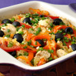 Royalty-Free Stock Photo: Baked rice with chicken, vegetables and olives in a saucepan