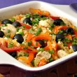 Baked rice with chicken, vegetables and olives in a saucepan — Stock Photo