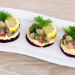 Appetizer with herring and beets — Stock Photo