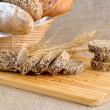 Постер, плакат: Diverse bread with slices of bread with grains