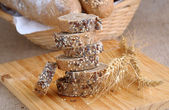 A stack of slices of bread with grains — Stock Photo
